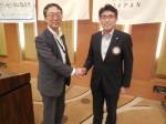根橋聖治会員と握手